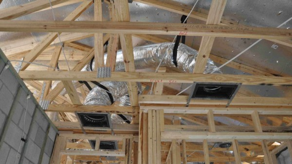 looking up at all the nail holes coming through radiant barrier after shingles installed