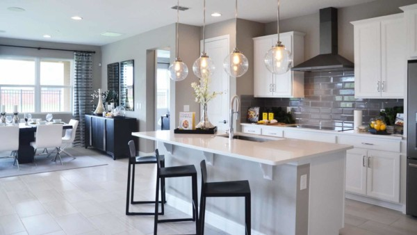 kitchen in model home showing cabinets, cabinet hardware & more