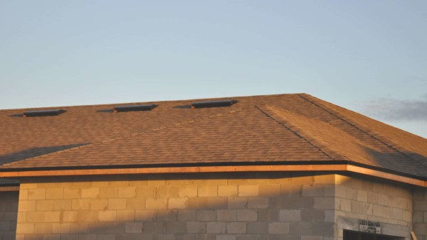 roofing shingles installed with drip edge & fascia board visible below