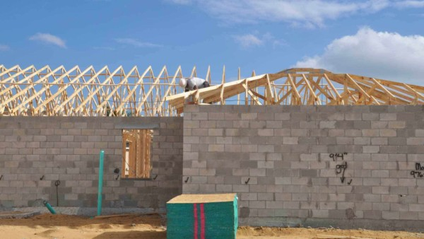 roof trusses on top of block wall (no fascia boards installed yet)