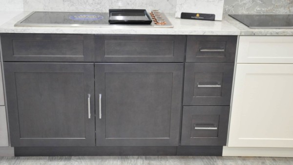 dark gray kitchen cabinet with chrome pulls