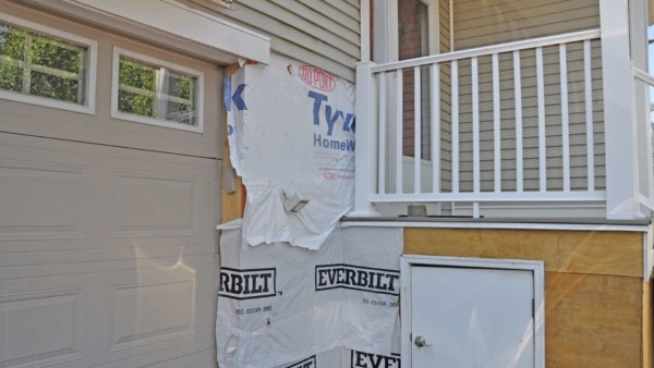 siding repairs around garage & front door due to wood rot