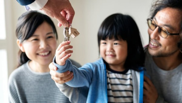 asian family getting keys to their new home, so they're half way through their moving checklist