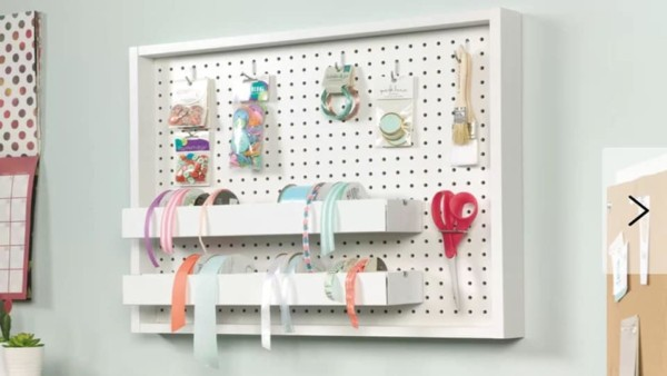 craft pegboard with hardware to organize ribbon