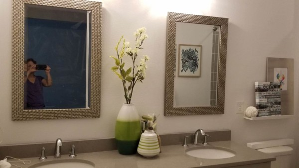 bathroom vanity with decorative mirrors instead of ugly plate glass, and photographing house contents like decorative vases