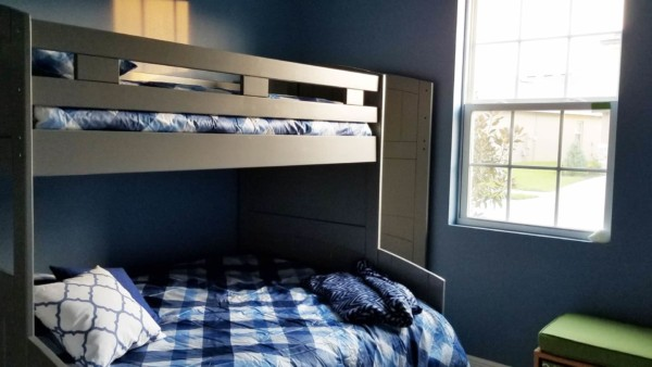 bunkbed for sleeping & playing, and photographing house contents including books & toys