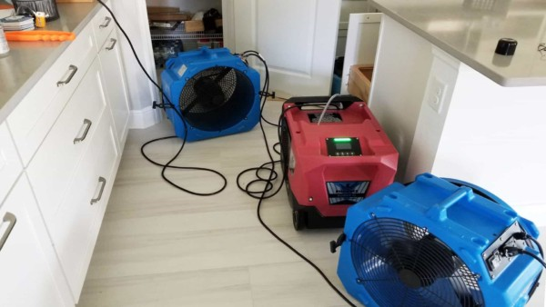 lots of fans (blue) and dehumidifiers (red) to dry out flooded house