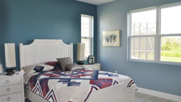 master bedroom in blue, with lots of color worth photographing house content including quilts