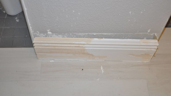 baseboard opposite water leak with paint peeled off, so definitely replacing baseboard here
