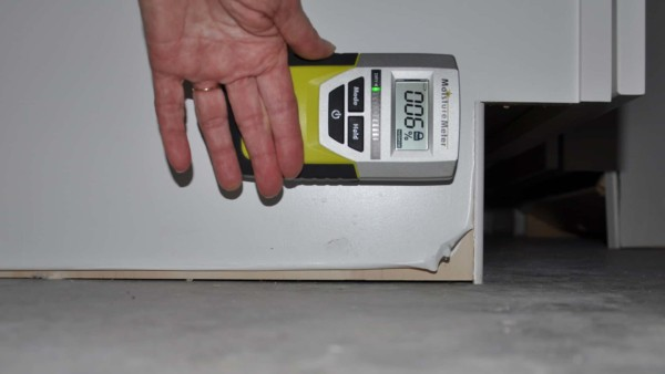 moisture meter reading of 6% on flooded base cabinets after 4 weeks to dry out kitchen cabinets