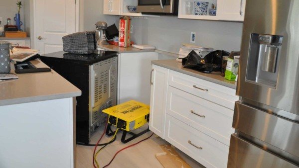 kitchen disarray after house flooded & needed drying out