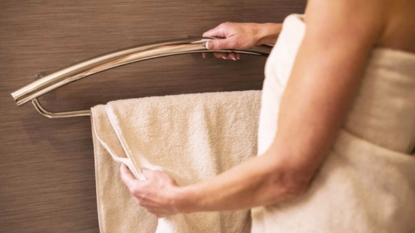 Combination towel rack with an integrated grab bar ...