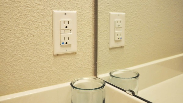 electrical outlets like this one are regulated by the electrical building code