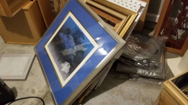 water damaged art was piled up in the garage but never dried ...