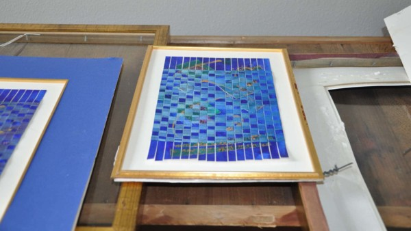 water damaged art must be disassembled to dry out each of the many layers like the art, mat boards, backing & frame