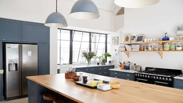 Kitchen design trends include colored cabinets like muted blue here ...