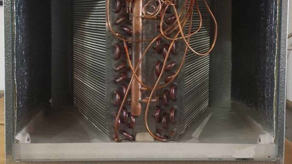 HVAC coils with drip pan beneath the coils to collect the water released from cooled air