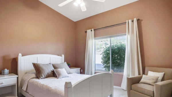 One-story house can have angled ceilings like this bedroom ...