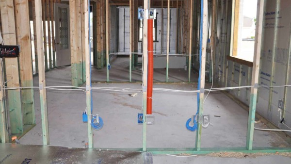 framed walls with electrical & low volt (electronics) wiring rough-in per your electrical checklist