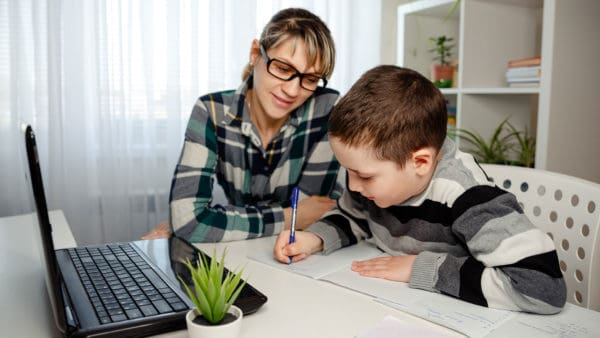 Mom helping son with schoolwork, in this homeschooling space ...