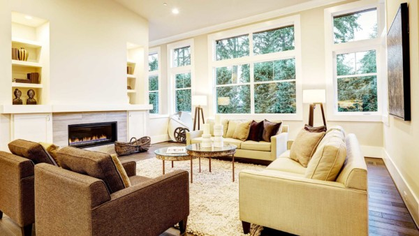 Built-in bookshelves & cabinets on either side of the fireplace in this relaxing living room