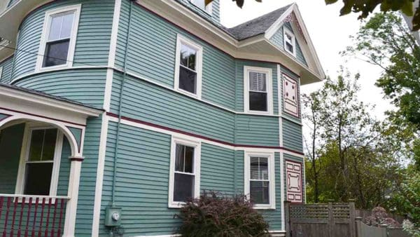 100 year old Victorian with wood siding ... lovely teal with deep rose trim