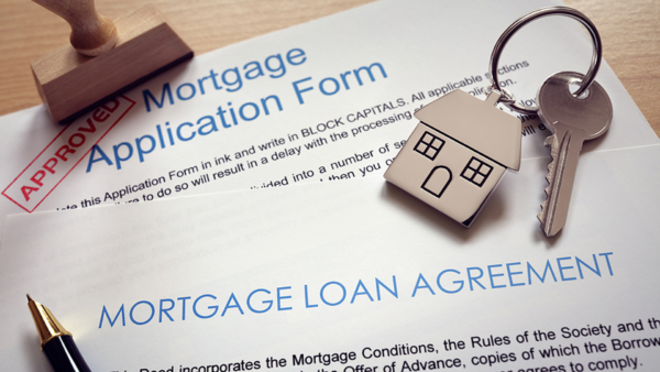 mortgage application, loan agreement & house keys representing home buying process
