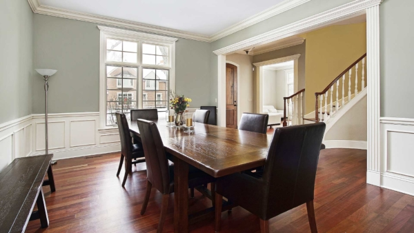 formal dining room with dark wooden table, leather chairs & eggshell paint