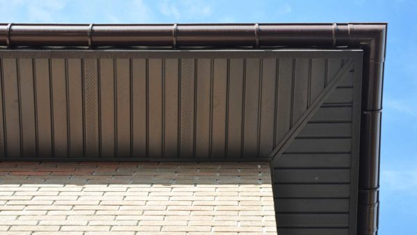 Continuous soffit vents, brown wrapping two sides of a roof